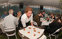 """Brandy Ames prepares to serve guests appetizers during Moulton Farms """"Taste of the Farm"""" four course dinner overlooking the Ossipee Mountains on Tuesday evening.  (Karen Bobotas/for the Laconia Daily Sun)"""