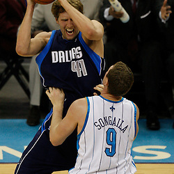 Mar 22, 2010; New Orleans, LA, USA; Dallas Mavericks forward Dirk Nowitzki (41) is guarded by New Orleans Hornets forward Darius Songaila (9) during the first half at the New Orleans Arena. Mandatory Credit: Derick E. Hingle-US PRESSWIRE