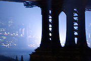 downtown Manhattan and Brooklyn bridge seen from under the Manhattan bridge