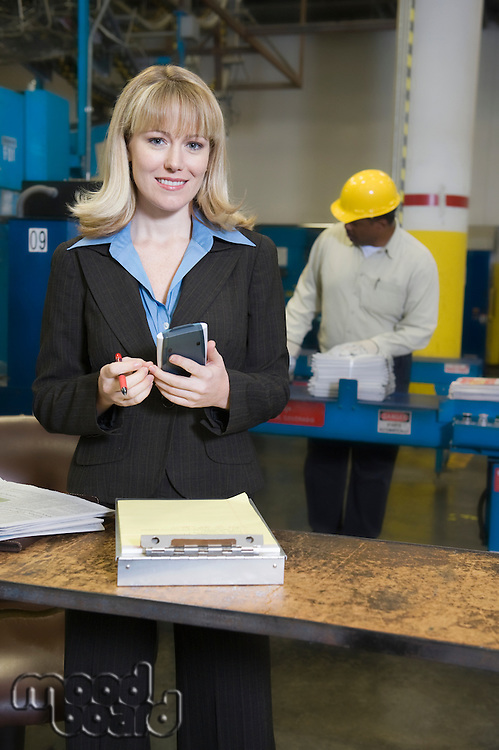 Smartly dressed woman working in newspaper factory