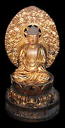 Seated wooden (gilded) Buddha depicted on a lotus pedestal with a halo. Japanese Edo period, 1784