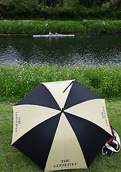 © Licensed to London News Pictures.13/06/15<br /> Durham, England<br /> <br /> A couple sit under an umbrella and watch the racing during the 182nd Durham Regatta rowing event held on the River Wear. The origins of the regatta date back  to commemorations marking victory at the Battle of Waterloo in 1815. This is the second oldest event of this type in the country and attracts over 2000 competitors from across the country.<br /> <br /> Photo credit : Ian Forsyth/LNP