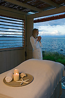 Candles, warm sheets, and the sound of waves along the seashore set the stage for a wonderful massage experience in a seaside massage hut. The Comox Valley, Vancouver Island, British Columbia, Canada.