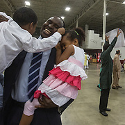"CHANTILLY, VA - SEP12: Mohamed Elsanousi scoops up his chidren, Anas, 5, and Jude, 4, following prayers at the Dulles Expo Center for Eid al-Adha, the ""Feast of the Sacrifice"", the second of two major holidays in Islam, September 12, 2016, in Chantilly, Vriginia.  The holiday honors the willingness of Ibrahim (Abraham) to sacrifice his son, as an act of submission to God's command. (Photo by Evelyn Hockstein/For The Washington Post)"