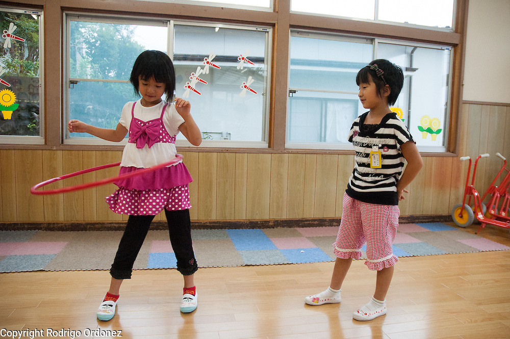 Girls play with a hoola hop at a child care center (jido club/gakudo) in Kamaishi, Japan.
