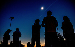 Eclipse watchers at the OSU Student Legacy Park watch the total solar eclipse in Corvallis on Monday, August 21, 2017. (August Frank/The Register-Guard)