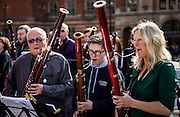 UNITED KINGDOM, London: 11 October 2015 To mark the  world's first International Bassoon Day, Bassoon players from around the world play there instruments on the steps of the Royal Albert Hall across the road from the Royal College of Music in London, England. The day had been launched to bring attention to the Bassoon and hopefully produce more players of the Bassoon as there numbers are dwindling. Picture by Andrew Cowie / Story Picture Agency