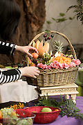 Arranging a decorative fruit basket
