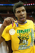 Devonte Robinson (20) of Dallas Madison reacts after receiving his state championship medal for defeating Houston Yates during the UIL 3A state championship game at the Frank Erwin Center in Austin on Saturday, March 9, 2013. (Cooper Neill/The Dallas Morning News)