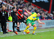 AFC Bournemouth midfielder Shaun MacDonald and Norwich City midfielder Matthew Jarvis during the Barclays Premier League match between Bournemouth and Norwich City at the Goldsands Stadium, Bournemouth, England on 16 January 2016. Photo by Graham Hunt.