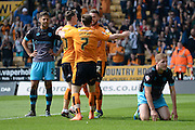 Wolverhampton Wanderers players celebrate the own goal by Sheffield Wednesday defender Michael Turner during the Sky Bet Championship match between Wolverhampton Wanderers and Sheffield Wednesday at Molineux, Wolverhampton, England on 7 May 2016. Photo by Alan Franklin.