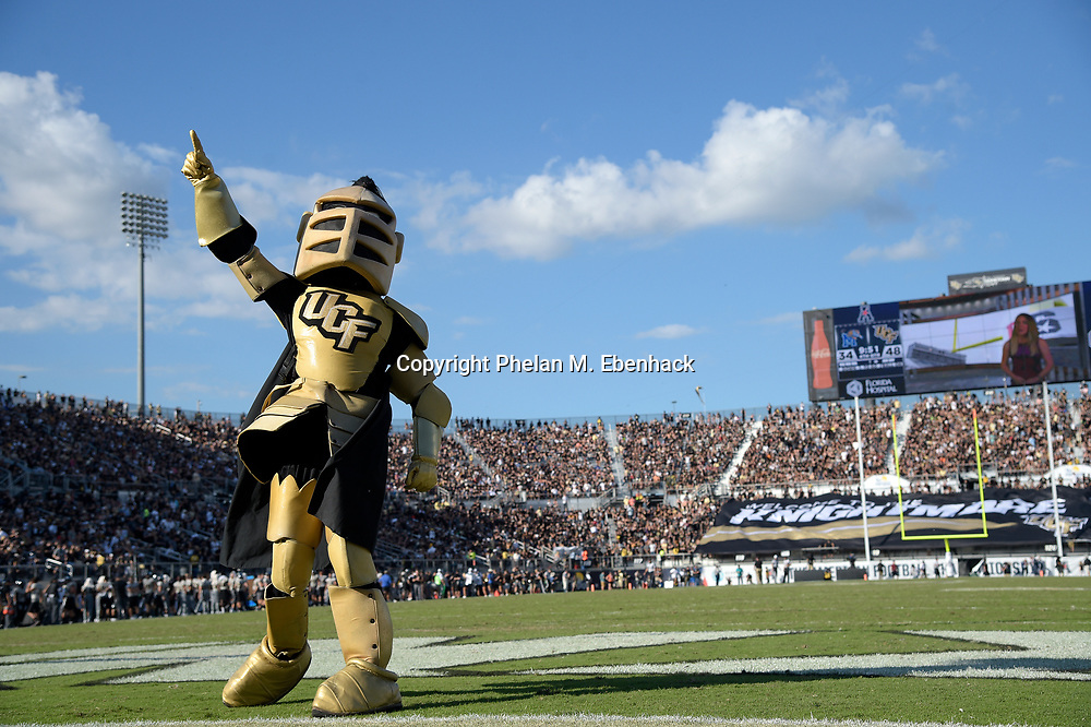 The Central Florida mascot Knightro leads the fans in a cheer during the second half of the American Athletic Conference championship NCAA college football game against Memphis Saturday, Dec. 2, 2017, in Orlando, Fla. Central Florida won 62-55. (Photo by Phelan M. Ebenhack)