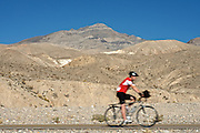 A cyclist rides through Death Valley National Park on Oct. 25, 2012.