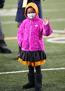 Leah Still, daughter of Cincinnati Bengals defensive tackle Devon Still (75), who was diagnosed with cancer, waves to fans as she appears on the field while a donation in the amount of $1,349,582.63 is made to the Cincinnati Children's Hospital Medical Center from jerseys sold as part of the 2014 Devon Still Jersey Program during the NFL week 10 regular season football game against the Cleveland Browns on Thursday, Nov. 6, 2014 in Cincinnati. The Browns won the game 24-3. ©Paul Anthony Spinelli