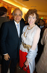 SIRDAR ALY AZIZ and MARCELLA, LADY DASHWOOD at a party to celebrate the publication of 'Made for Maharajas' by Dr Amin Jaffer hosted by Louis Vuitton at their store on Sloane Street, London on 10th October 2006.<br />