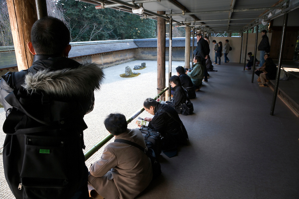 tourists at the Ryoanji Temple zen garden in Kyoto