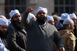 "London, February 8th 2015. Muslims demonstrate outside Downing Street  ""to denounce the uncivilised expressionists reprinting of the cartoon image of the Holy Prophet Muhammad"". PICTURED: Muslims trade insults with right wing counter-protesters from the English Defence League and Britain First."