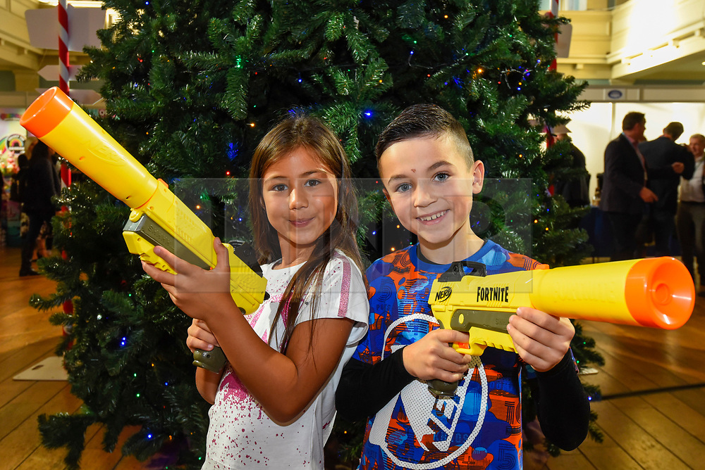 "© Licensed to London News Pictures. 13/11/2019. LONDON, UK. Ayva (aged 7) and Joshua (aged 8) play with Nerf Elite Fortnite SP-L Nerf guns by Hasbro at the preview of ""DreamToys"", the official toys and games Christmas Preview, held at St Mary's Church in Marylebone.  Recognised as the countdown to Christmas, the Toy Retailer's Association, an independent panel of leading UK toy retailers, have selected the definitive and most authoritative list of which toys will be the hottest property this Christmas.  Photo credit: Stephen Chung/LNP"