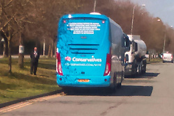 © Licensed to London News Pictures . 20/04/2015 . Crewe , UK . The Conservative Party bus pictured parked on a double yellow line , outside the venue . George Osborne and David Cameron speaking in an Arriva train shed in Crewe , Cheshire as part of the Conservative Party's election run . Photo credit : LNP
