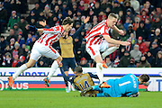 Arsenal forward Theo Walcott fouled by Stoke City Defender Ryan Shawcross during the Barclays Premier League match between Stoke City and Arsenal at the Britannia Stadium, Stoke-on-Trent, England on 17 January 2016. Photo by Alan Franklin.