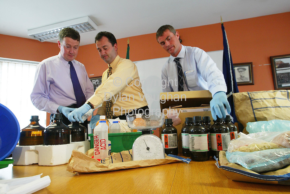 13/7/2004.Detective Garda Mark Wall, Sgt Tont Lonergan, Garda Martin Power pictured with some of the cocaine and equipment found in Kilkenny..Picture Dylan Vaughan