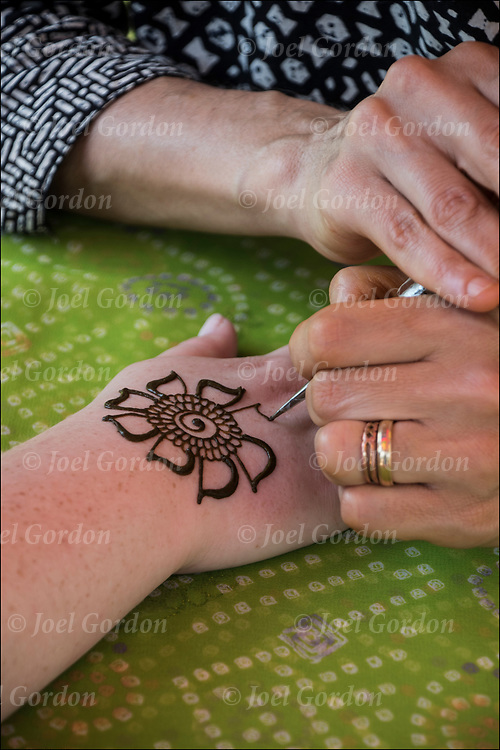 Henna dsign tattoo by Mangala Buhler-Rose in Washington Square Park at the Hare Krishna Festival of Chariots. <br />