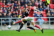 Aden Flint (4) of Bristol City closes down Pierre-Michel Lasogga (9) of Leeds United during the EFL Sky Bet Championship match between Bristol City and Leeds United at Ashton Gate, Bristol, England on 21 October 2017. Photo by Graham Hunt.