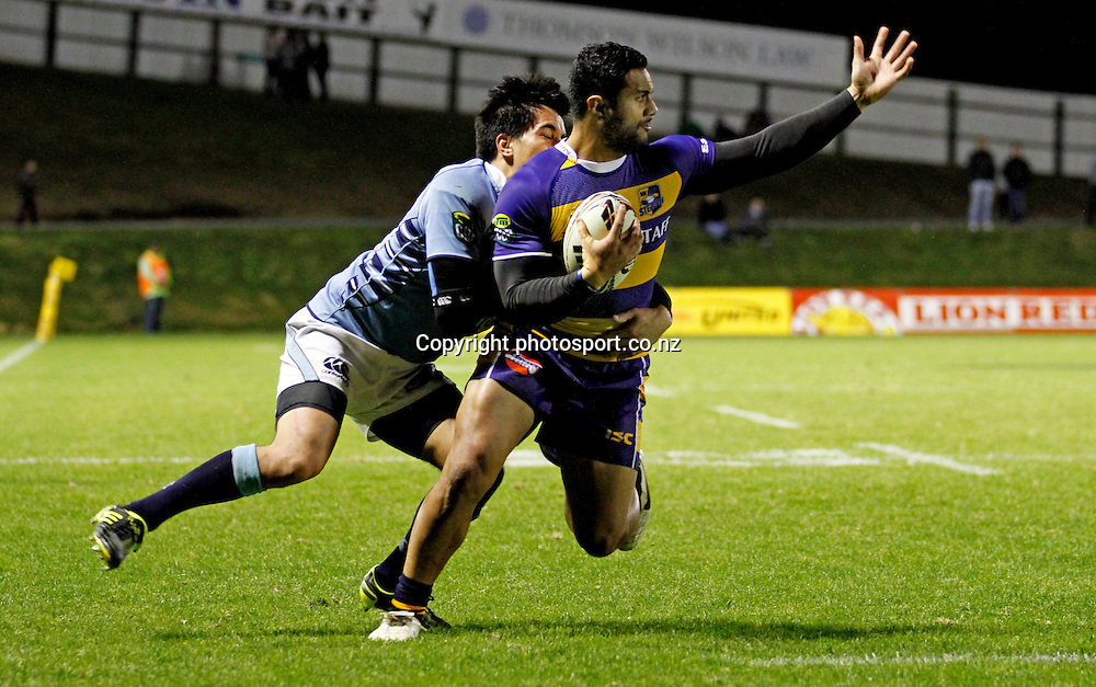 Bay of Plenty player Lelia Masaga is caught by Northland's Ash Moeke in the ITM Cup Northland v Bay of Plenty, 4 August  2011 played at Toll Stadium Whangarei, New Zealand 4 August  2011. Photo: Kenny Rodger/ photosport.co.nz