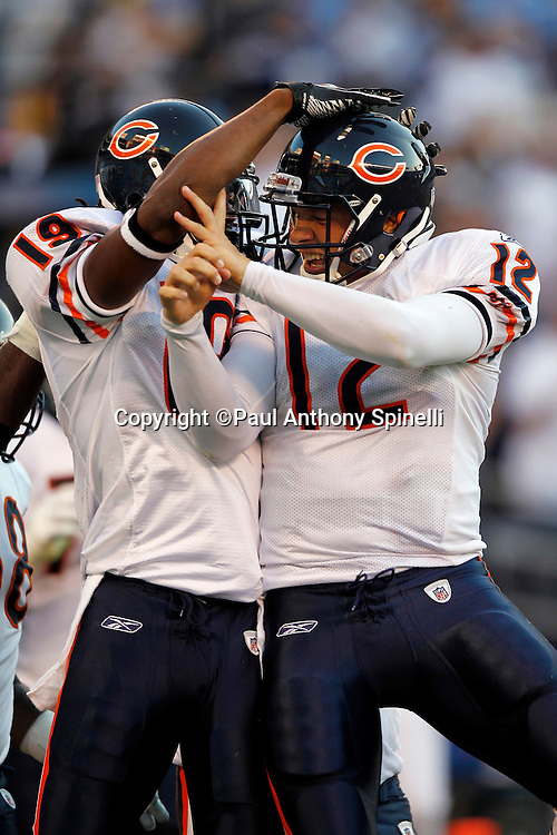 Chicago Bears wide receiver Devin Aromashodu (19) celebrates with Bears quarterback Caleb Hanie (12) after catching a 7 yard touchdown pass in the second quarter that gives the Bears a 10-7 lead while covered by San Diego Chargers cornerback Nathan Vasher (31) during a NFL week 1 preseason football game against the San Diego Chargers, Saturday, August 14, 2010 in San Diego, California. The Chargers won the game 25-10. (©Paul Anthony Spinelli)