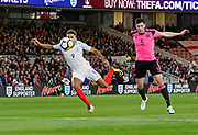 Dominic Calvert-Lewin of England goes to ground after a challenge from Scott McKenna of Scotland during the U21 UEFA EURO first qualifying round match between England and Scotland at the Riverside Stadium, Middlesbrough, England on 6 October 2017. Photo by Paul Thompson.