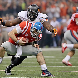 Jan 1, 2016; New Orleans, LA, USA; Oklahoma State Cowboys defensive tackle Vincent Taylor (96) sacks Mississippi Rebels quarterback Chad Kelly (10) during the first quarter in the 2016 Sugar Bowl at the Mercedes-Benz Superdome. Mandatory Credit: Derick E. Hingle-USA TODAY Sports