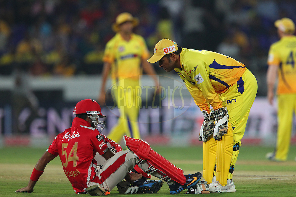 M S DHONI (Captain) of the Chennai Superkings checks to see how Manan VOHRA of the Kings XI Punjab  is after he was hit on the ankle by a delivery during the second semi final match of the Oppo Champions League Twenty20 between the Kings XI Punjab and the Chennai Superkings held at the Rajiv Gandhi Cricket Stadium, Hyderabad, India on the 2nd October 2014<br /> <br /> Photo by:  Ron Gaunt / Sportzpics/ CLT20<br /> <br /> <br /> Image use is subject to the terms and conditions as laid out by the BCCI/ CLT20.  The terms and conditions can be downloaded here:<br /> <br /> http://sportzpics.photoshelter.com/gallery/CLT20-Image-Terms-and-Conditions-2014/G0000IfNJn535VPU/C0000QhhKadWcjYs