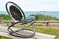 Rocking Chair made from recycled chromed - steel bicycle rims with padded vinyl cushions