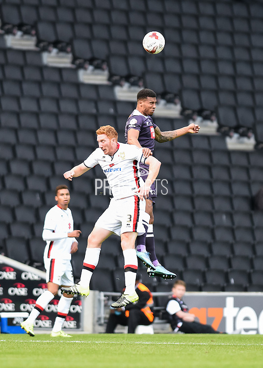 Derby County defender Cyrus Christie and Milton Keynes Dons defender Dean Lewington during the Sky Bet Championship match between Milton Keynes Dons and Derby County at stadium:mk, Milton Keynes, England on 26 September 2015. Photo by David Charbit.