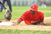Anfernee Roberts of Homewood-Flossmoor slides back to first ahead of the throw against Stagg, Monday, April 11th, 2011 in Palos Hills l Gary Middendorf~for Sun-Times Media