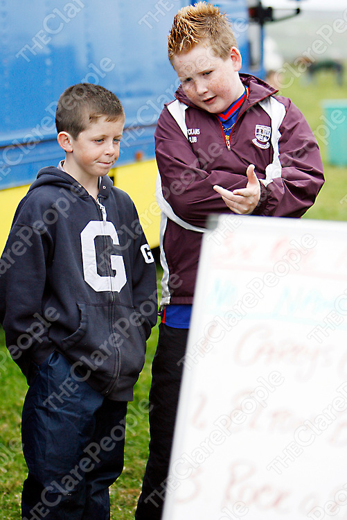 Ian Queally and Cian Doherty check out the runners and riders for the next race at the Lisdoonvarna races over the weekend.<br />