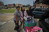 Incoming freshman Olivia Battle of Batesville, Miss., with her parents Ollie and Arthur, moves her belongings into a dorm as students began moving in at the University of Mississippi in Oxford, Miss. on Wednesday, August 17, 2011. Classes for the fall semester begin Monday, August 22, 2011.