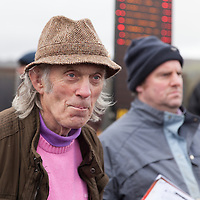 Tom Molloy watching the odds at the East Clare Harriers 2015 Killaloe point to point