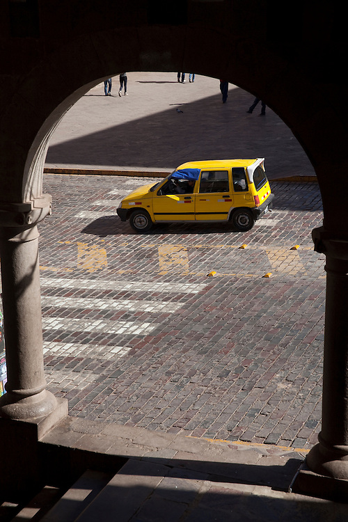 Traditional yellow taxi on the stretd of Cuzco, Peru.