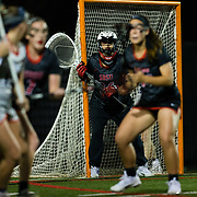 23 March 2018: San Diego State Aztecs goal keeper Katy Sharretts looks through traffic as a Liberty player looks to shoot in the first half. The Aztecs beat the Lady Flames 11-10 Friday night. <br /> More game action at sdsuaztecphotos.com