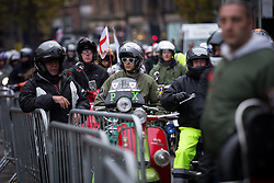 © Licensed to London News Pictures . 08/11/2015 . Manchester , UK . Greater Manchester scooter clubs pay tribute at the Remembrance Sunday service at the Cenotaph in Manchester . Photo credit : Joel Goodman/LNP