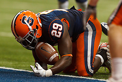 Oct 21, 2011; Syracuse NY, USA;  Syracuse Orange running back Antwon Bailey (29) dives into the end zone to score a touchdown against the West Virginia Mountaineers during the fourth quarter at the Carrier Dome.  Syracuse defeated West Virginia 49-23. Mandatory Credit: Jason O. Watson-US PRESSWIRE