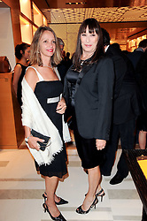 Left to right, SABRINA GUINNESS and ANJELICA HUSTON at a party to celebrate the opening of the Louis Vuitton Bond Street Maison, New Bond Street, London on 25th May 2010.
