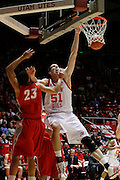 Utah center David Foster (51) dunks the ball as New Mexico guard Phillip McDonald (23) defends during an NCAA college basketball game, Wednesday, Jan. 19, 2011, in Salt Lake City. (AP Photo/Colin E Braley)