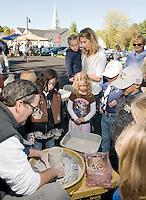 Aaron Witham demonstrates his pottery skills for Taeylor Plante, Sophia Lehr, Alex Richardson and Nicholas Hinds with Charlotte and Heidi Lehr looking on during Gilford's 4th annual Heritage Festival held Saturday. (Karen Bobotas/for the Laconia Daily Sun)