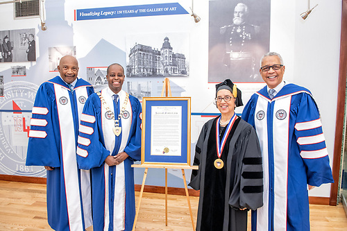 Chairman of the Board Stacey Mobley, President Wayne A.I. Frederick, an honoree and a trustee with a citation.