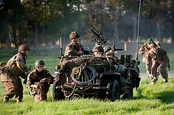 Reenactors portraying British paratroops of the 6th airborne division with a willys jeep take part in a battle reenactment on the Pickering show ground October 2011<br />