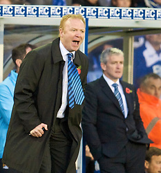 BIRMINGHAM, ENGLAND - Sunday, November 1, 2009: Birmingham City's manager Alex McLeish and Manchester City's manager Mark Hughes during the Premiership match at St Andrews. (Pic by David Rawcliffe/Propaganda)