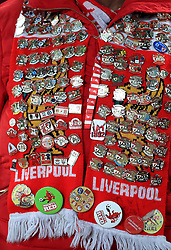 Close up of a Liverpool fan's pin badges before the UEFA Champions League match at Anfield, Liverpool.