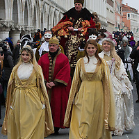 VENICE, ITALY - FEBRUARY 11:  The traditional parade of '12 beautiful Venetian girls' forms part of the Festa delle Marie in St Mark's Square on February 11, 2012 in Venice, Italy.The annual festival, which lasts nearly three weeks, will see the streets and canals of Venice filled with people wearing highly-decorative and imaginative carnival costumes and masks.
